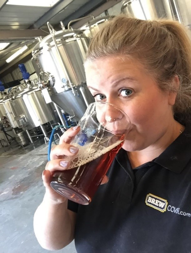 Here is Louise, Our Development Executive, enjoying a beer at the Beer Brothers Brewery.