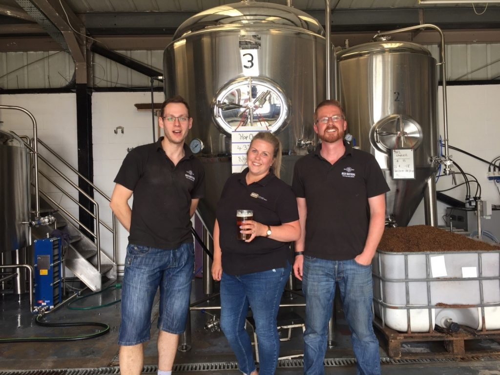 This is Louise Twist, our Development Executive, with the Beer Brothers at their brewery.